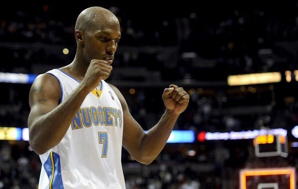Chauncey Billups celebrates after the Denver Nuggets defeated the Dallas Mavericks during their NBA basketball game in Denver