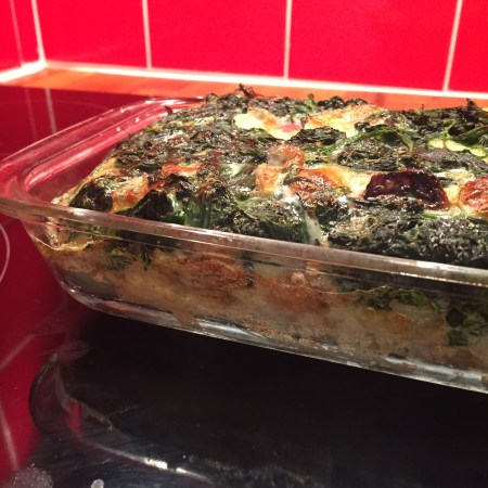 Team No Waste: A breakfast casserole featuring French bread, eggs, Brussels sprouts, spinach, and mozzarella cheese.