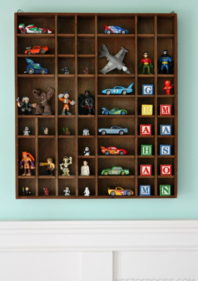 toy display for action heros & cars