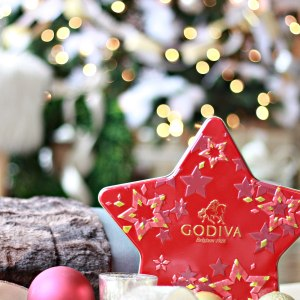 Give the gift of Luxury.  A gift box of Godiva Chocolate, a candle and a beautiful faux fur blanket