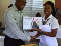 Mr. Vernon Connor, Youth Advisor, presents participation gift to student