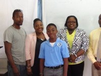 Jaden K M Dore flanked by his parents and Hon Hazel Brandy-Williams and Mr. Keith Glasgow