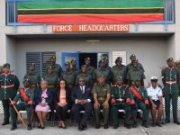 (front row seated) Cabinet Secretary Josephine Huggins (2nd left) Senator Honourable Wendy Phipps (3rd left) PM Harris (4th left) Lt. Col. Wallace (5th left) with graduating class and other SKNDF members