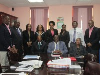 From left to right (seated) ECCB Governor Mr. Timothy Antoine, Prime Minister Harris Dr. the Honourable Timothy Harris, and Cabinet Secretary Mrs. Josephine Huggins.  Standing from left to right: Deputy Prime Minister Honourable Shawn Richards; Attorney-General Honourable Vincent Byron Jr; Financial Secretary Mrs. Hilary Hazel; Senator Honourable Wendy Phipps; Ms. Karen Williams, Director of ECCB's Research Department; Mrs. Merlese O'Loughlin, Director of the Legal Services Department at the Central Bank; Honourable Eugene Hamilton, and Honourable Mark Brantley.  Photo by Ms. Valencia Grant, Press Secretary.