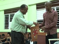 Director of Culture Troy Mills (left) gives a present to dance workshop facilitator Marlon Simm
