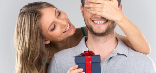 woman giving a gift to a man
