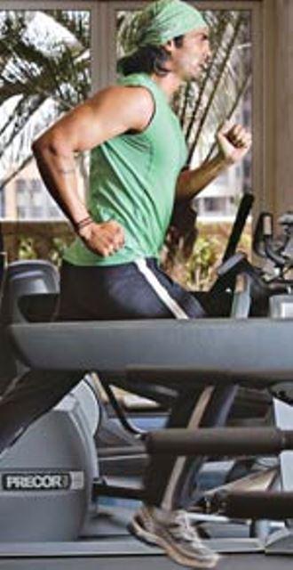 arjun rampal running on a treadmill