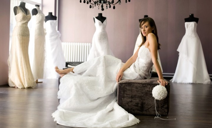 bride in a wedding dress boutique