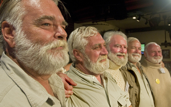 """Finalists in the 2010 """"Papa"""" Hemingway Look-Alike contest, including from left, Michael Morrow of Greenwood, Mo.; Matt Gineo of Jensen Beach, Fla.; Denis Golden of Rockford, Mass.; Charles Bicht of Vero Beach, Fla., and Tom Mitchell of Rock Hill, S.C., try to impress the judges late Saturday, July 24, 2010, at Sloppy Joe's Bar in Key West, Fla. After his 12th attempt, Bicht won the annual contest, a facet of the island city's annual Hemingway Days celebration that ends Sunday, July 25. (Andy Newman/Florida Keys News Bureau)"""