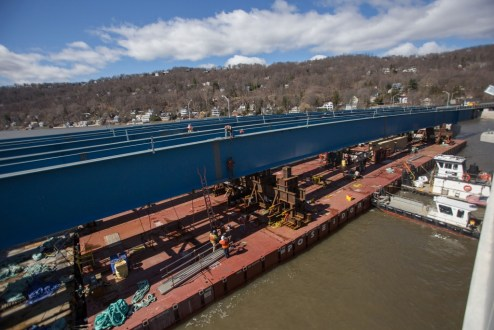 March 29, 2017 - A girder assembly for the eastbound bridge is barged to its final position near the Rockland landing.
