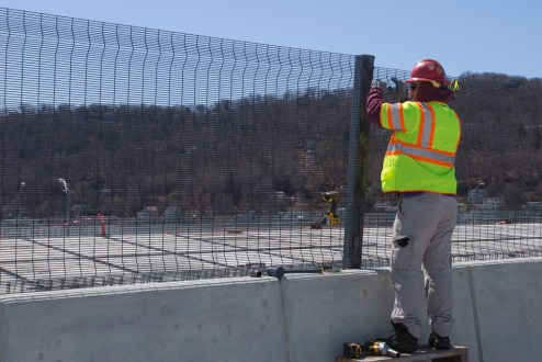 March 29, 2017 - Fencing is installed atop a concrete barrier on the Rockland approach.