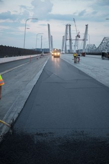 August 3, 2017 - The project team paves the final driving surface on the westbound span.