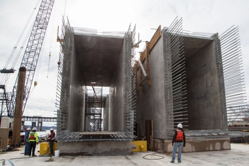 February 4, 2016 - Precast crossbeams are prepared for installation on the main span.