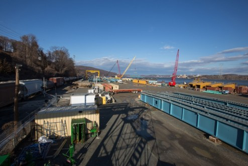 February 1, 2017 - At the project's Tomkins Cove facility, workers assemble steel girders into larger sections for the new main span.