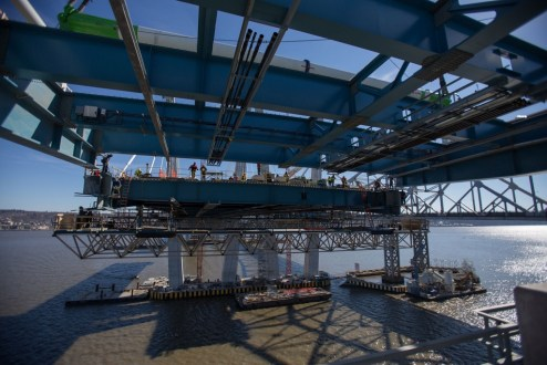 February 17, 2017 - A massive section of structural steel is lowered between the main span and Rockland approach.