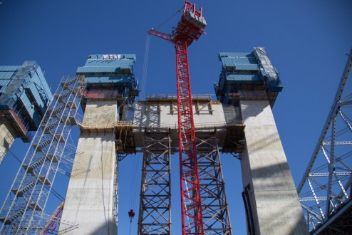 February 22, 2016 - The project's red tower cranes assist with construction at the main span.
