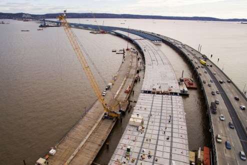 December 28, 2015 - The new westbound span with hundreds of road deck panels in place.