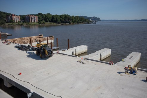 June 28, 2017 - Crews use temporary formwork to cast the concrete dock fingers.