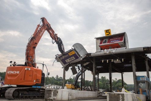 May 27, 2016 - Crews remove former toll plaza structures.