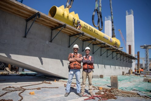April 16, 2016 - Crew members provide scale for an enormous precast pier cap.