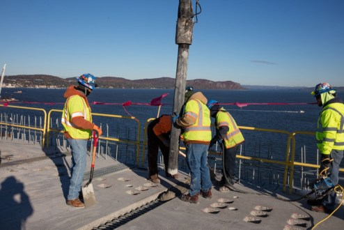 October 26, 2016 - Crews pour concrete for the main span roadway.