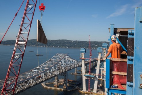 September 14, 2016 - A tower crane raises formwork for the top of a main span tower.