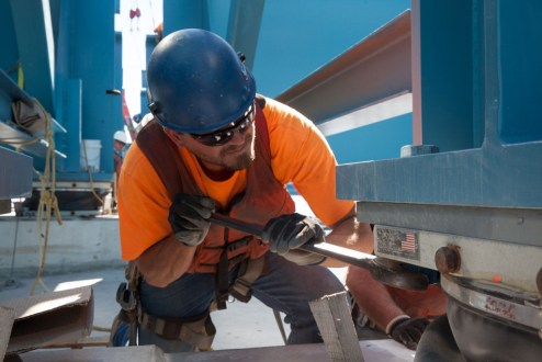 October 6, 2016 - An ironworker helps connect the final westbound girder assembly.