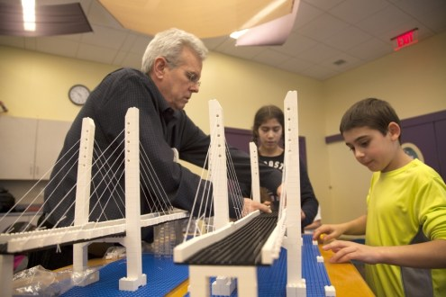February 24, 2014 - Outreach team member Andrew O'Rourke and local children build a LEGO replica of the New NY Bridge at the Trove, White Plains Library