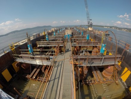 August 26, 2014 - Inside one of the project's main span pile caps as it is lowered into the river.