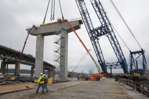 May 6, 2015 - The new bridge's first pier cap, installed along the temporary Westchester work trestle.
