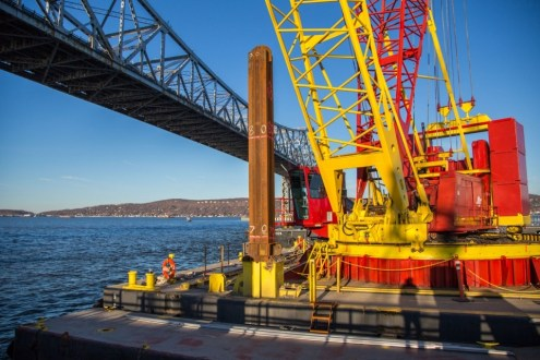 March 31, 2015 - The new bridge's foundations are installed with the help of large, barge-mounted cranes.
