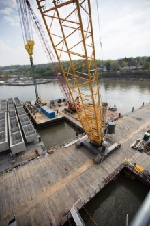 May 5, 2015 - Cranes aboard a temporary work trestle help prepare for the installation of several precast pier caps.