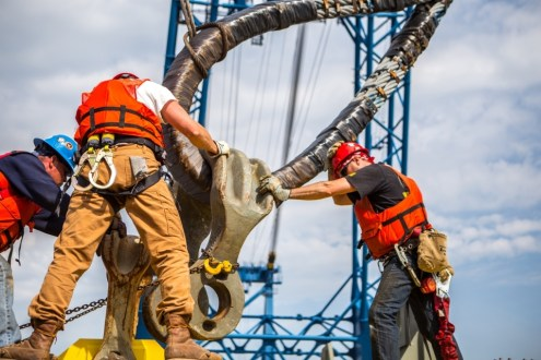 May 5, 2015 -  Workers adjust enormous clamps onto I Lift NY's rigging system.