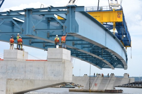 June 17, 2015 - The project's first steel girder assembly is slowly lowered to its final location atop a pair of concrete piers.
