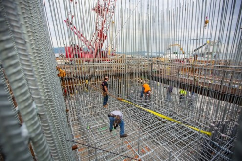 June 30, 2015 - Ironworkers carefully tie countless steel bars within what will one day be a 419-foot tower.