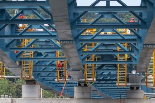 June 30, 2015 - Crews align enormouse girder assemblies, which will support the new bridge's road deck.