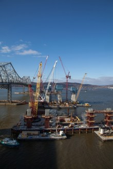 December 4, 2015 - Tower cranes assist with construction of the anchor piers (foreground) and main span towers (background).