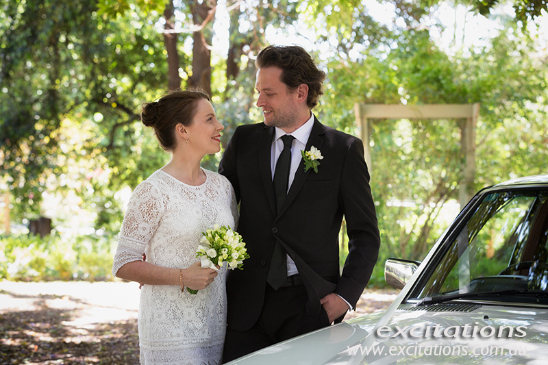 Bride and groom photographed in an old garden. Half length, soft focus. Merbein wedding photography by Excitations Mildura photograpy.