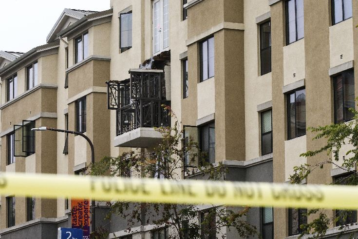 Damage is seen at the scene of a 4th-story apartment building balcony collapse in Berkeley, California