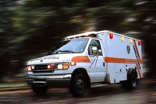 Ambulance speeding down road (blurred motion)