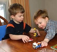 boys play with lego toys