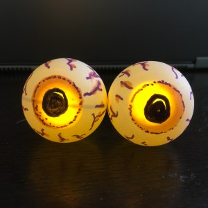 scary halloween eyes made from ping pong balls and LEDs