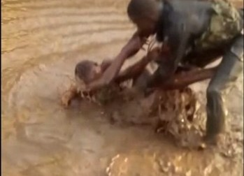 Officer Mohammed dipping woman in Mud water