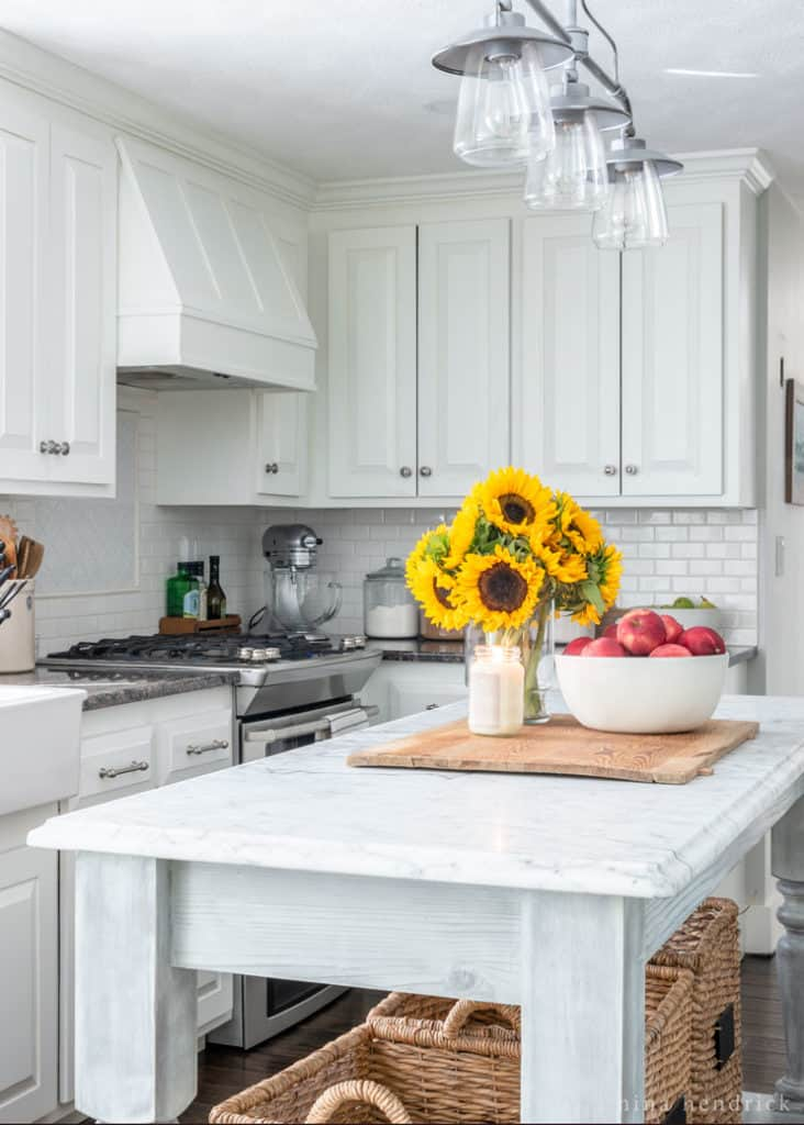Simple Early Fall Kitchen Decorating Ideas   Nina Hendrick Design Co      white kitchen cabinets with sunflowers and apples