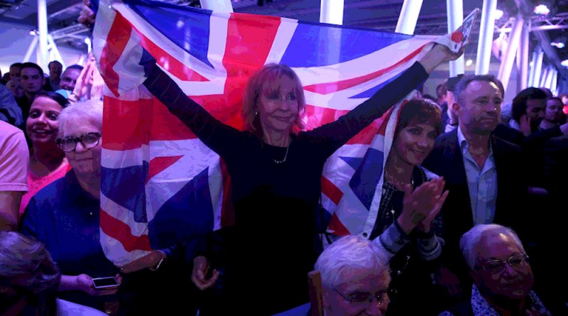 A Brexit supporter holds a Union Flag at a Vote Leave rally in London, Britain June 4, 2016. REUTERS/Neil Hall - RTSG0YI