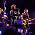 E Street Band members Nils Lofgren and Jake Clemons perform with Bruce Springsteen.