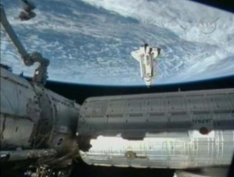 STS130 docking 568x430 Endeavour Day 3 Starts with Docking at ISS photo