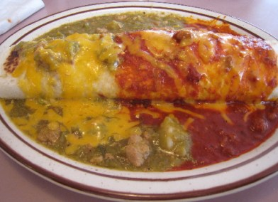 A breakfast burrito stuffed with chorizo, potatoes and egg.