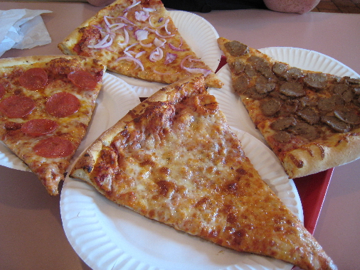Four slices of Saggio's pizza.