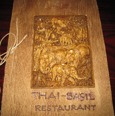 The menu cover features three-dimensional elephants.